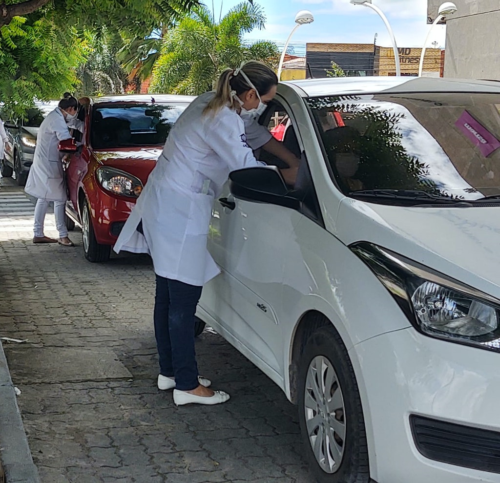 Use of parking lots at Via Sul Shopping in Brazil for seasonal flu vaccination clinics.